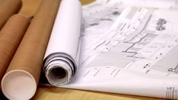 Blueprints on architects desk Footage