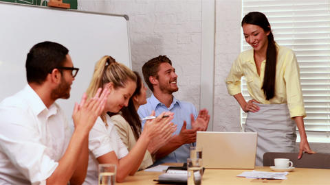 Casual business team clapping at presentation Footage