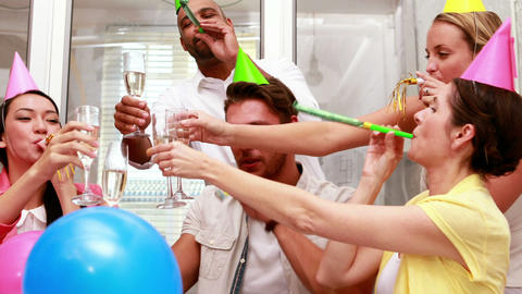 Casual business team celebrating with champagne Footage