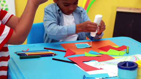 Cute little boys having art time in the classroom Footage