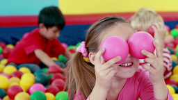 Cute children playing and having fun in the ball pool Footage