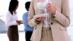 Business people standing and having coffee Footage