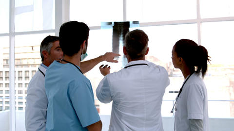 Team of doctors analysing an xray together Footage