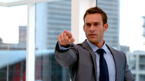 Stern handsome businessman pointing ahead Footage