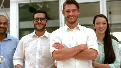 Casual business team smiling at camera with arms crossed Footage