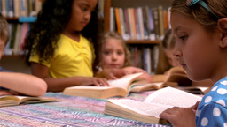 Young class reading books in the library Footage