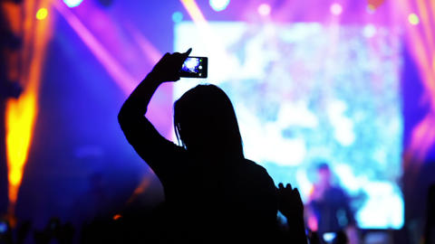 Girl With A Smartphone At A Rock Concert stock footage