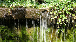 Falling Water Pouring From Small Stream stock footage