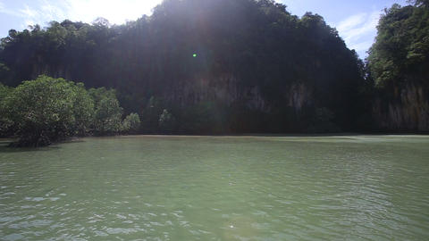 small boat sailing in the lagoon among the rocks Footage
