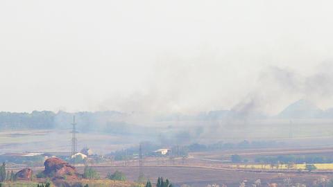 Fire in the village. Lights wheat field. FULL HD Footage