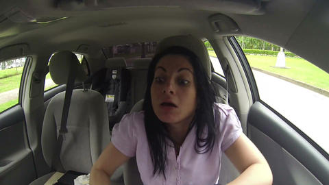 Gorgeous woman driver looking back and parking car Footage