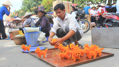 man selling cotton dog toy in the market, Asia Live Action
