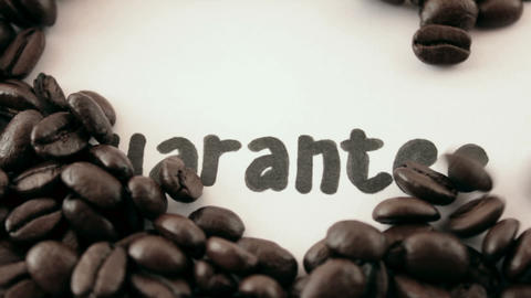 guarantee. written on white under coffee Stock Video Footage