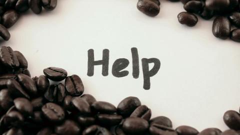 help. written on white under coffee Stock Video Footage