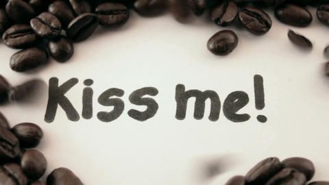 kiss me. written on white under coffee Stock Video Footage