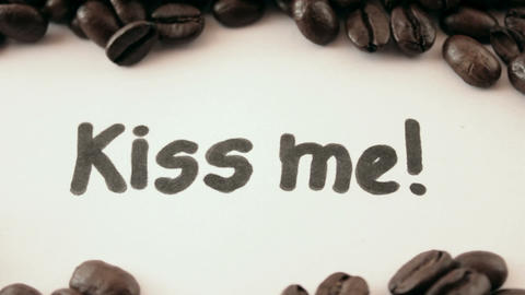 kiss me. written on white under coffee Footage