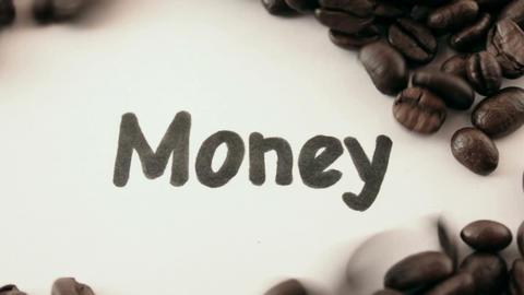 Money. written on white under coffee Stock Video Footage