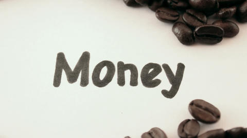 Money. written on white under coffee Stock Video Footage