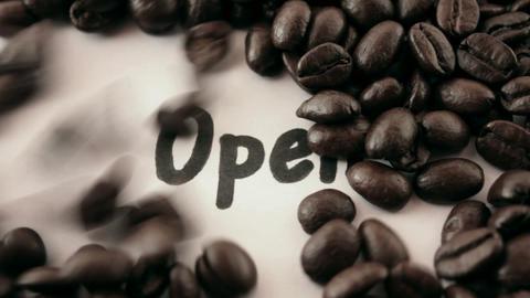 open. written on white under coffee Stock Video Footage