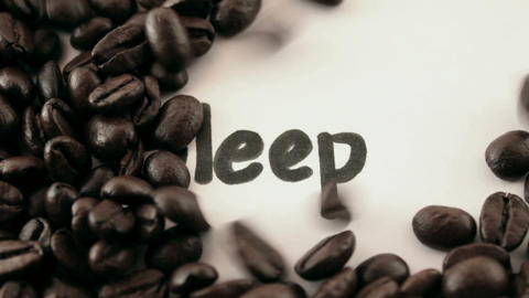 sleep. written on white under coffee Stock Video Footage