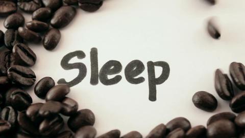 sleep. written on white under coffee Stock Video Footage