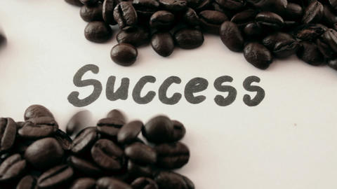 success. written on white under coffee Stock Video Footage