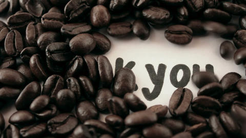 thank you. written on white under coffee Stock Video Footage