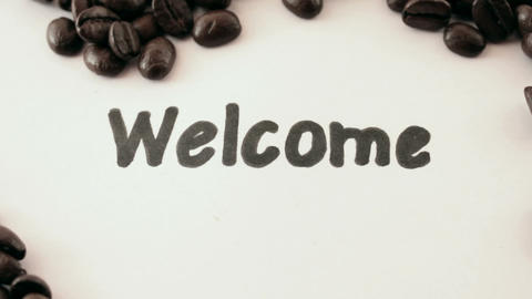 welcome. written on white under coffee Stock Video Footage