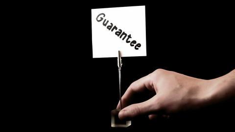 guarantee. written on white Footage