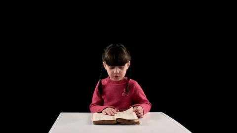 reading girl on black background Footage
