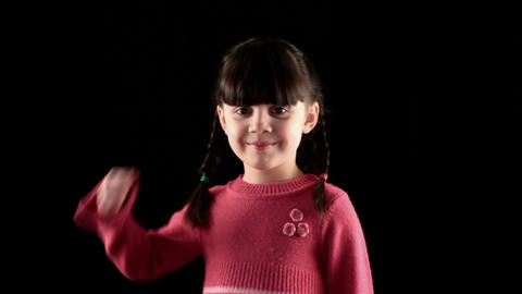 play the fool girl on black background Stock Video Footage