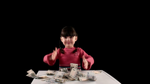 Girl finds money on black background Stock Video Footage