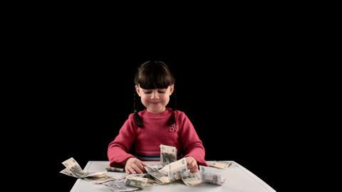 Girl finds money on black background Footage