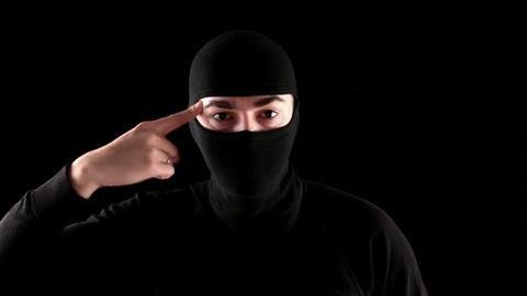 ninja cramps fool on black background Stock Video Footage