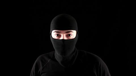 Ninja says stop on black background Stock Video Footage