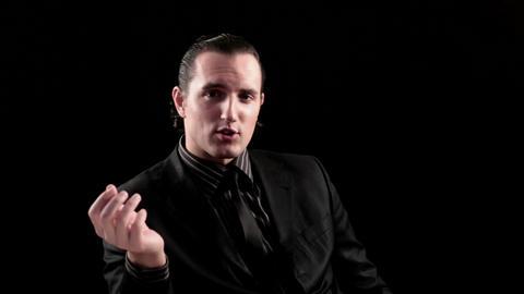 businessman speaks on black background Stock Video Footage