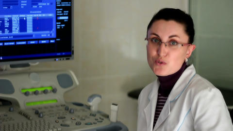 Doctor tells of Ultrasound inspection in a clinic Stock Video Footage