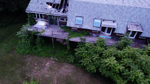 In Air Flight Above Wooden Neglected Vacant Buildi stock footage