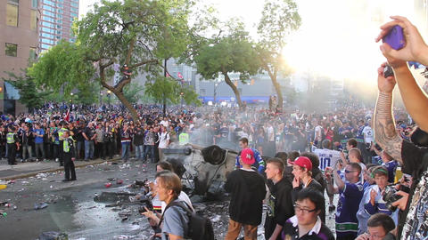 Pan left to right of massive rioting crowd - Footage