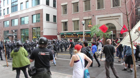 Protesters and police line walking towards each ot Footage