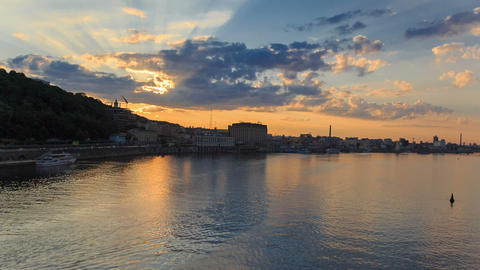 Sunset timelapse in Kyiv on Dnipro river with boat Footage