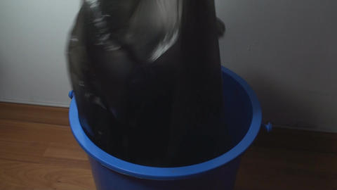 Man Picking Up Trash Bag From A Bin, Eco, Indoors, Footage