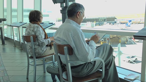 People waiting for thier flight at YVR airport Footage