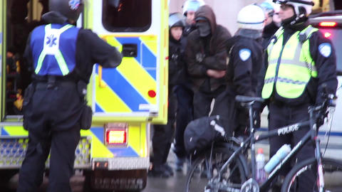 Injured masked rioter going into ambulance Footage