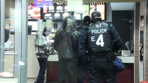 Riot officers going to fast-food restaurant Footage
