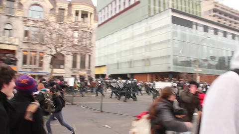 Riot police run and smash fence onto protesters Footage