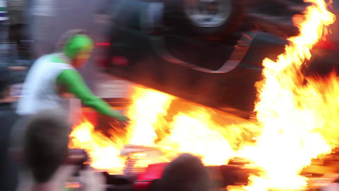 Man Sets Car On Fire In Front Of Crazy Rioters stock footage