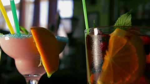 Dolly shot of four refreshing cocktails on the bar Footage