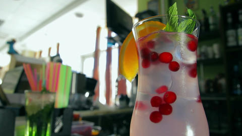 Dolly shot of refreshing cocktail with cranberry,  Footage
