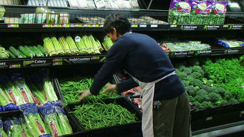 Man Inspecting Green Beans In Produce Footage